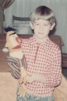 David, age eight, poses at home with a famous television celebrity, 1973.